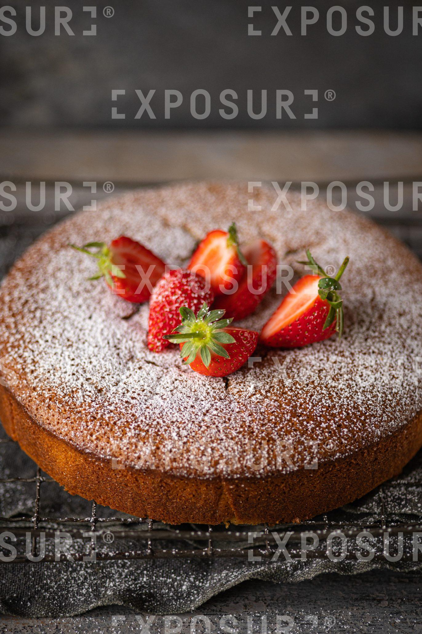 Pistachio, polenta and olive oil cake with strawberries