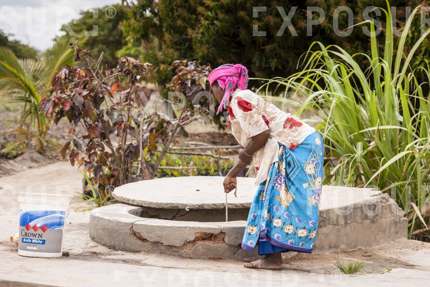 Drawing water from a well. Malawi