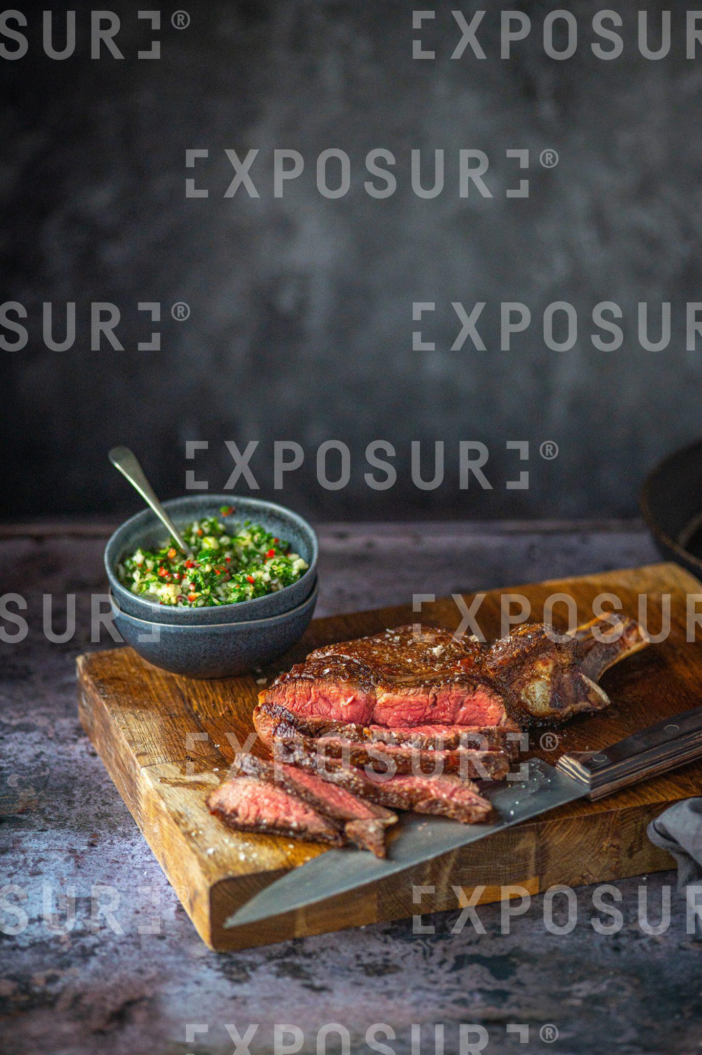 Medium-rare steak and chimichurri sauce